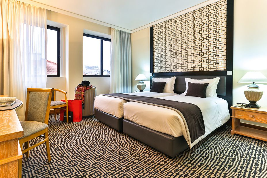 Eén van de ruime kamers van hotel Mundial