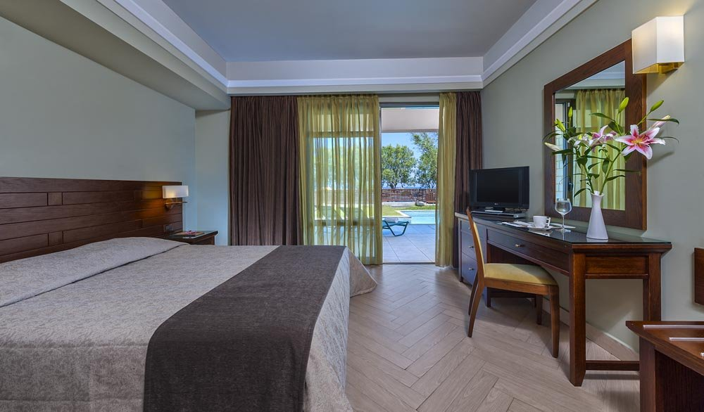 Hotel Porto Platanias Beach Resort & Spa - kamer tuin- of zwembadzicht