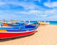Last minute Portugal - vissersbootje aan strand